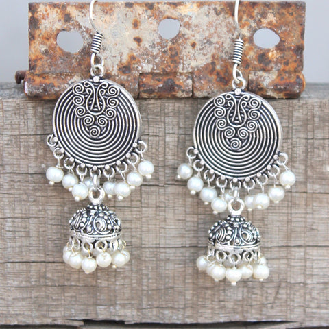 Earrings: Jhumka with silver color, germen silver metal with pear embelishment