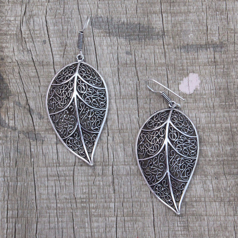 Earring: Leaf shape danglers silver color