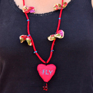Up-cycled textile heart pendant necklace( Fly) by bebaak