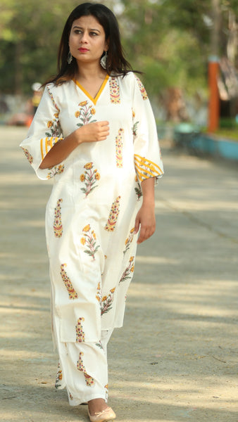 Mughal Print off white v neck kurti online at bebaakstudio.com
