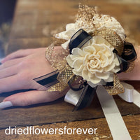 Gold, black, and ivory white dried flower prom corsage