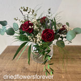 Preserved real red roses and eucalyptus arrangement