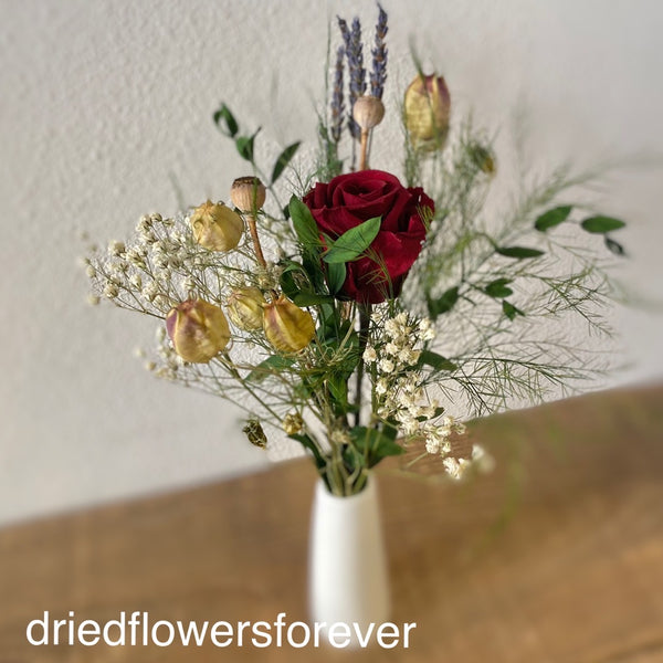Dried red rose petite flower bouquet with white ceramic bud vase