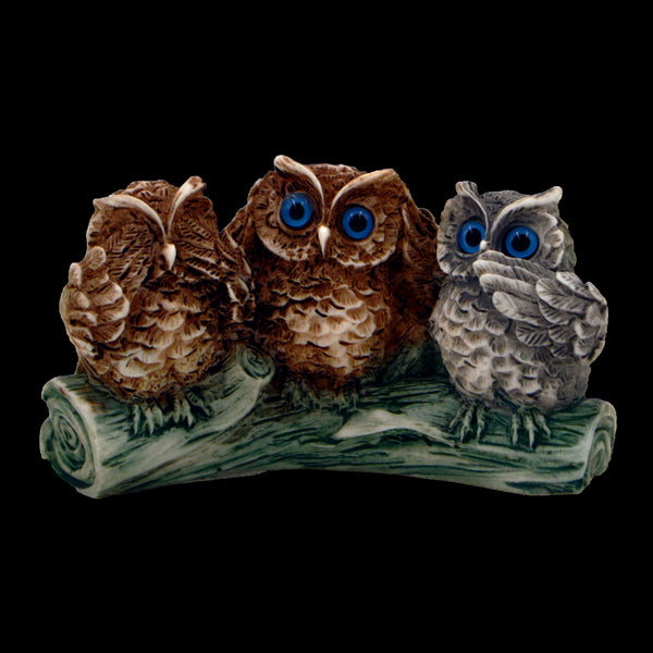 Owls on a green branch