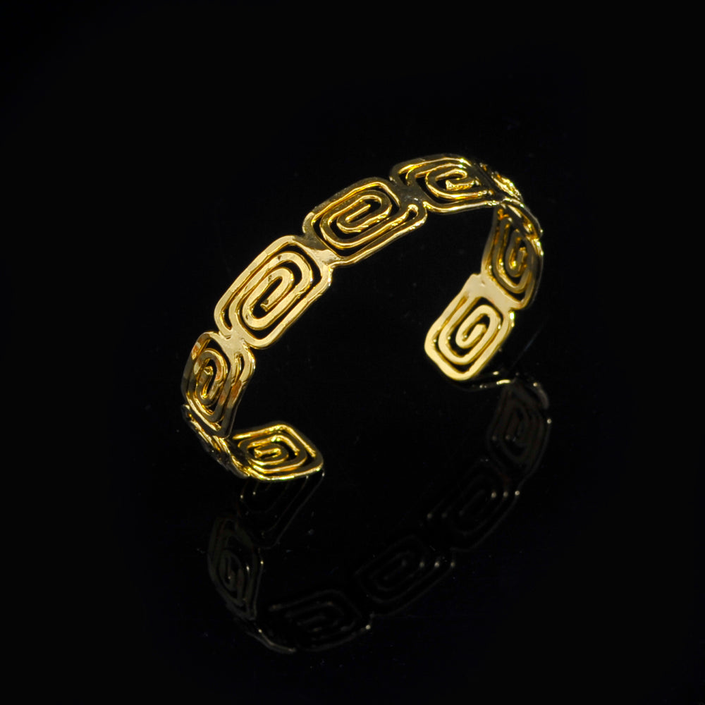 Gold plated bangle meandros symbol of eternity