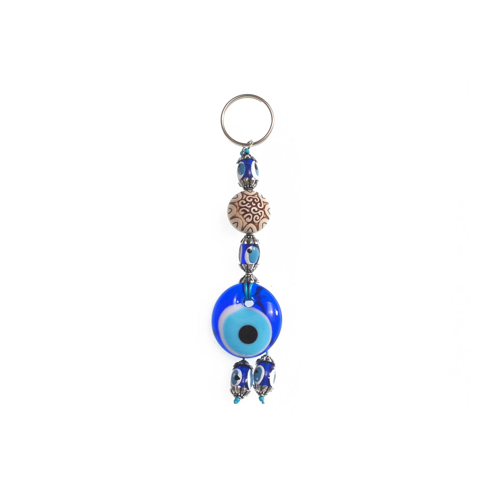 Keychain charm for the evil eye light brown