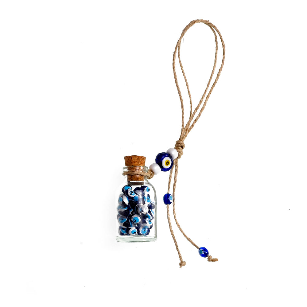 Keychain charm for the evil eye with a bottle full of evil eyes
