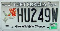 Georgia Give Wildlife a Chance License Plate black numbers on grey with Humming Bird and 2 flowers