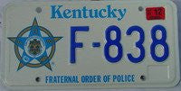 Kentucky Fraternal Order of Police license plate blue numbers on white with F.O.P. Star emblem