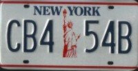 New York State Statue of Liberty License Plate blue numbers on white with red Statue of Liberty
