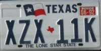 Texas Lone Star State License Plate with Blue Letters on White Backround