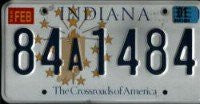 Indiana Crossroads of America License Plate black numbers on white with gold emblem