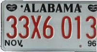 Alabama License Plate red numbers on white with 2 Black Heart of Dixie emblems