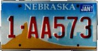 Nebraska License Plate red numbers on blue Cityscape