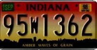 Indiana Waves of Grain License Plate black numbers on red yellow sunset with farm silhouette