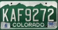 Colorado Green Mountains License Plate white numbers on green with embossed mountains