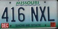 Missouri Show-Me State License Plate blue numbers on whitw blue green