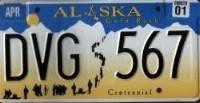 Alaska Gold Rush Centennial license plate black numbers on blue white and yellow