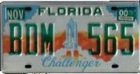 Florida Challenger License Plate green numbers on blue white orange sunset with Shuttle liftoff