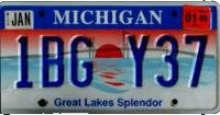Michigan Great Lakes Splendor License Plate blue numbers with red Sunset on Lake with Bridge Silhouette