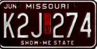 Missouri Show-Me State License Plate white numbers on maroon