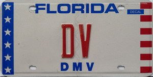 Florida DMV License Plate red numbers on white with white stars on blue and red stripes on white