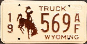 Wyoming Truck Steel License Plate with brown Bucking Bronco on cream