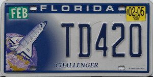 Florida Challenger license plate blue numbers on white blue with Challenger Space Shuttle in orbit
