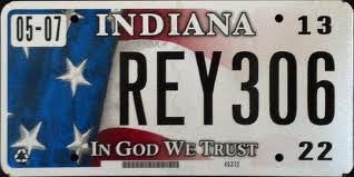 "Indiana State License Plate with "" in God We Trust"" Logo and Black Letters on Red White & Blue Flag"