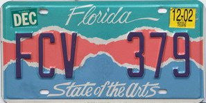 Florida State of the Arts License Plate dark blue numbers on teal pink blue