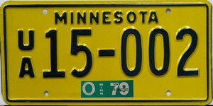 Minnesota License Plate dark green numbers on yellow with green sticker