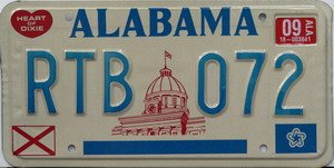 Alabama Capitol License Plate blue numbers on white with red Heart of Dixie and State Flag