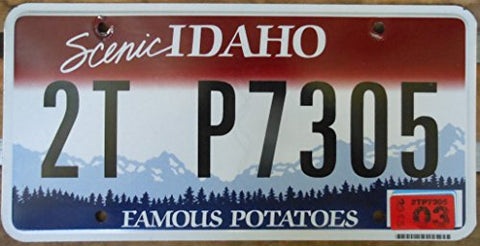 Idaho state license plate black letters on red backround with white and blue mountians Flat