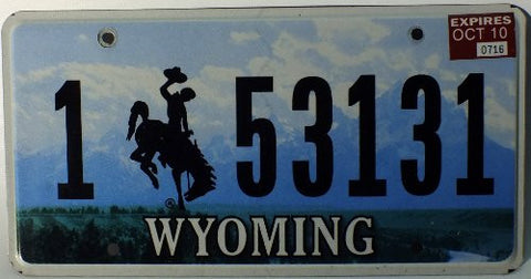 Wyoming License Plate with black numbers and Bucking Bronco on sky flat non-embossed
