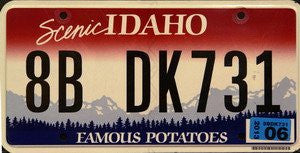 Idaho Famous Potatoes License Plate Black Numbers on Red White with Blue Mountains Non Embossed Flat