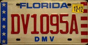 Florida DMV license plate red numbers on white with white stars on blue bar and red white stripes