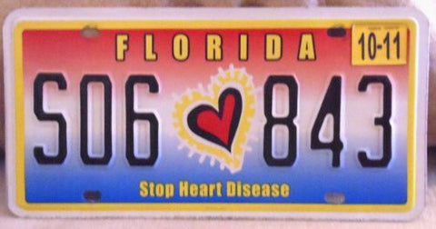Florida Stop Heart Disease license plate black numbers on red white blue with red black and yellow heart