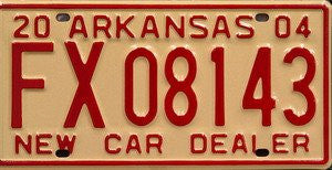 Arkansas New Car Dealer license plate red numbers on cream
