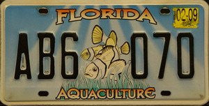 Florida Aquaculture license plate black numbers on blue white sea bottom with 2 yellow fish
