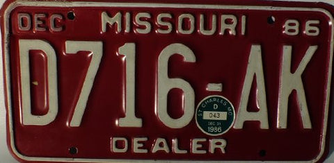 Missouri 1986 Dealer License Plate white numbers on maron