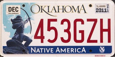 OK-104 Oklahoma Native America license plate red numbers on white with Native American shooting bow and arrow flat non-embossed