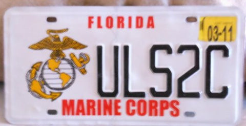 Florida Marine Corps license plate black numbers on white with Marine Corps insignia