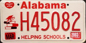 Alabama Helping Schools License Plate red numbers on white with school books