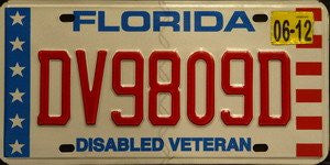 Florida Disabled Veteran license plate red numbers on white with white stars on blue bar and red white stripes