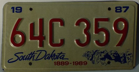 South Dakota 1987 License Plate White back ground with Mt Rushmore