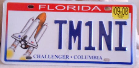 Florida Challenger-Columbia license plate blue numbers on white with Space Shuttle