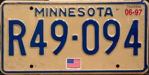 Minnesota license plate blue numbers on cream