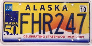 Alaska License Plate blue numbers on yellow orange with white mountains and blue Alaska 50 emblem