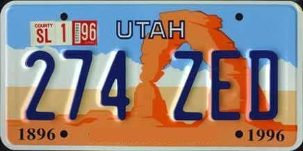 Utah State License Plate Blue Letters on Light Blue White and Orange Backround with Arch