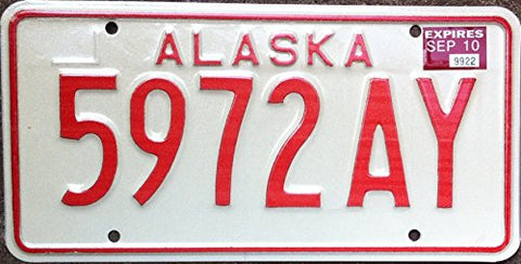 Alaska State License Plate Red Letters On Creme Backround